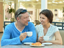 Happy couple at breakfast. On the table Stock Photography