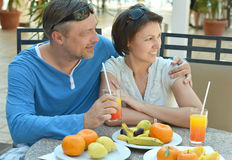 Happy couple at breakfast. On the table Royalty Free Stock Photo