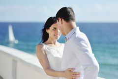 Happy couple bride and groom near sea in wedding day Stock Photography