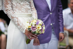 Happy couple, bride and groom at wedding aisle with bouquet clos Stock Photo