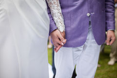 Happy couple, bride and groom at wedding aisle holding hands clo Royalty Free Stock Photo
