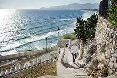 Happy couple bride and groom in wedding day in Italy Royalty Free Stock Image