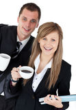 Happy couple of business holding a coup smiling Stock Photo
