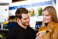 Happy couple in butcher shop Stock Images