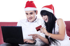Happy couple buying christmas gift online Royalty Free Stock Image