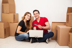 Happy couple buying furniture royalty free stock images
