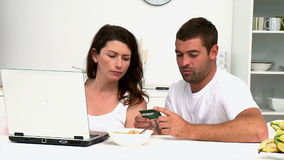 Happy couple buying on internet with a credit card Stock Image