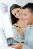Happy couple buying on line with credit card Royalty Free Stock Photo