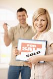 Happy couple buying new house stock photography