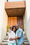 Happy couple after buying new house. Portrait of happy couple after buying new house stock image
