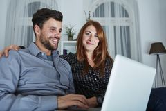Happy couple buying online presents Royalty Free Stock Image