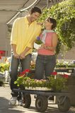 Happy Couple Buying Plants Stock Image
