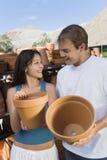 Happy Couple Buying Pots Stock Photos