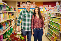 Happy couple buying some groceries Stock Photo