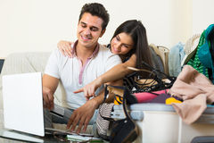 Happy couple buying tickets online Stock Image