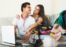 Happy couple buying tickets online Royalty Free Stock Photo