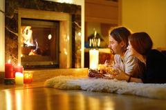 Happy Couple By A Fireplace On Christmas Stock Photography