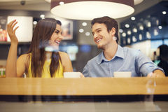 Happy couple in cafe Stock Images