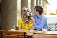 Happy couple in the cafe Royalty Free Stock Image