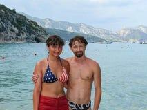 Happy couple on Cala Luna Bay Stock Images