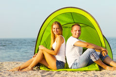 Happy couple camping on the beach. Summertime Royalty Free Stock Images