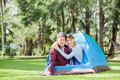 Happy Couple Camping In Park Stock Photography