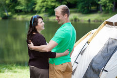 Happy couple on camping. Portrait of happy snuggled couple on camping Stock Photography