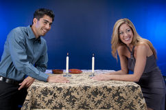 Happy couple at candlelit  table Stock Photo