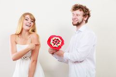 Happy couple with candy bunch flowers. Love. Royalty Free Stock Photos