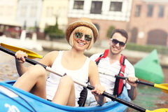 Happy couple in a canoe Stock Images