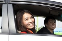 Happy couple in the car Royalty Free Stock Image