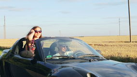 Happy couple on car. concept of carefree and stock video
