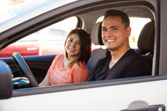 Happy couple in a car Stock Image