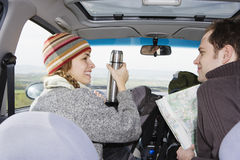 Happy Couple In Car During Road Trip Royalty Free Stock Photos