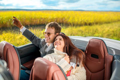 Happy couple in the car Stock Photography