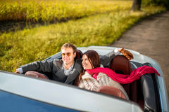 Happy couple in the car royalty free stock photography