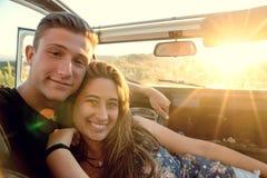 Happy couple in a car Stock Photos