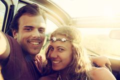Happy couple in a car royalty free stock image