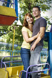 Happy couple on the carousel Royalty Free Stock Photo