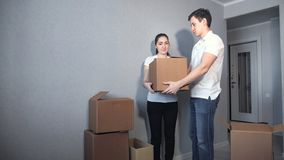 Happy Couple Carrying Boxes Into New Home On Moving Day royalty free stock photos