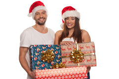 Happy couple carrying Christmas gifts Royalty Free Stock Photos
