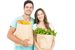 Happy couple carrying grocery bags Royalty Free Stock Photography