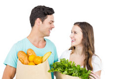 Happy couple carrying grocery bags Royalty Free Stock Photo