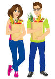 Happy couple carrying grocery paper bags Royalty Free Stock Photography