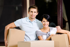 Happy couple carrying pasteboard containers Royalty Free Stock Photo