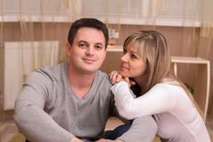 Happy couple in casual clothes having rest at home. Happy couple in casual clothes having rest at home royalty free stock photos