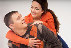 Happy couple in casual clothes on a light grey background Stock Images