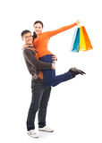 Happy couple in casual clothes with shipping bags Royalty Free Stock Photo