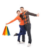 Happy couple in casual clothes with shipping bags Stock Photo