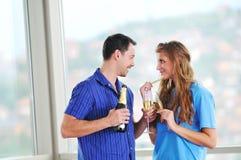 Happy couple celebrate Stock Images
